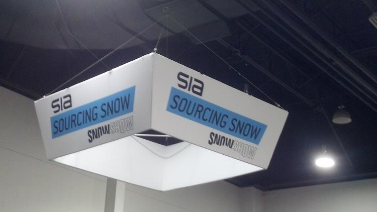 A sign hangs over the Sourcing Show, a section of the SIA Snow Show at the Colorado Convention Center that highlights companies that make clothing linings and other ingredients in name-brand products.