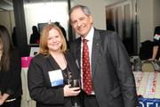 L to R: Michelle Stuhl, Advertising Account Executive greets Power Party guest.