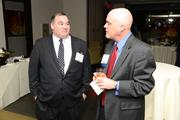 A guest at the PBJ Book of Lists Power Party talks with Editor Craig Ey.