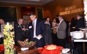 Guests gather at the hors d'oeuvres bar. Because food is good.