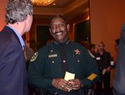 Orange County Sheriff Jerry Demings was on hand, in case things got out of hand at the cupcake tower.