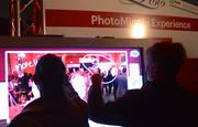 Guests write captions on a touch-screen at the interactive photo booth experience