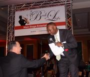 Karl Pearson of TD Bank mingles and congratulates the winner of one of the evening's raffles.