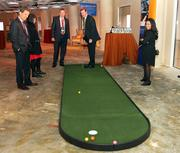 Attendees has the chance to play a few rounds of putt-putt at the USI Insurance Services green.