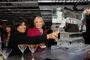 Tammy Levent and Ami Forte receive their cocktails through The Forte Group's special ice sculpture. The Forte Group was a sponsor.