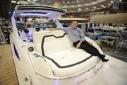 Davie Bigge, regional president of Marine Max, sits on a rumble seat of the Sea Ray 350 SLX, new for 2014.