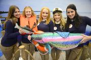 """Boat show sponsor Progressive offers """"Flotos"""" to visitors with (from left) Jackie Tieri, Maria Thompson, Caitlin Larson, Laura Lynne Tapper and Chelsey Brown."""