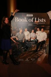 Say cheese: Ellie McMullen of Capital Adventures, with the cover, which features five well-known Washington chefs