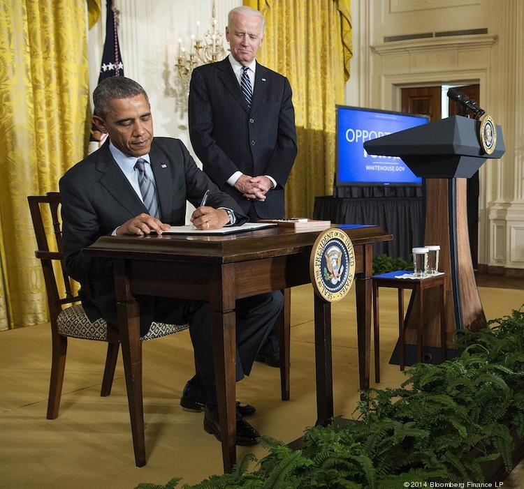 President Barack Obama signs a memorandum directing federal agencies to make sure they're giving the long-term unemployed a fair shot at government jobs.
