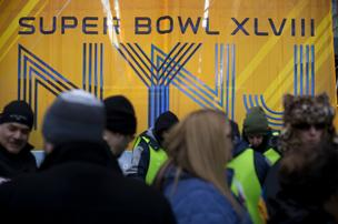 Fans visit Super Bowl Boulevard in New York, U.S., on Thursday, Jan. 30, 2014. Super Bowl Boulevard Engineered by GMC, a promotional zone for the big game on Sunday, spans 13 blocks of Broadway in Times Square.
