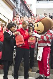 Drake and his wife, Brenda, got a welcome present from Brutus Buckeye at the Ohio Union.