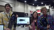 Jacob Howe, Theresa Blake and Jake Thamm of Crescent Moon of Boulder show off new snowshoe designs and their online customization platform at the 2014 SIA Snow Show.