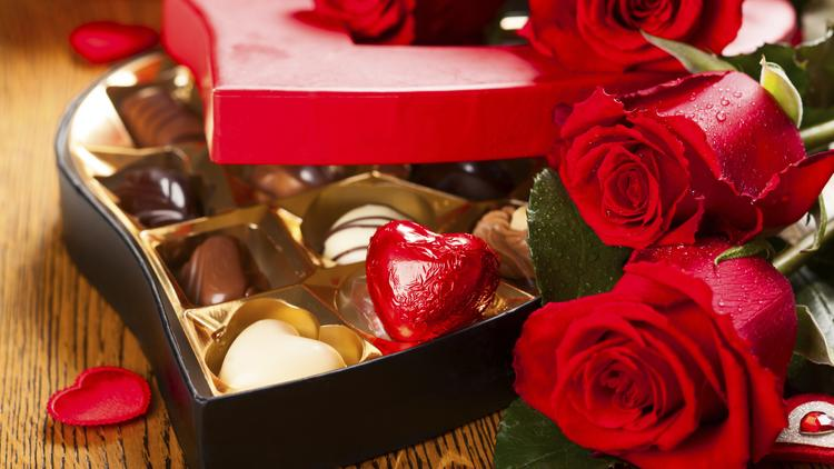 Thinking of buying candy for Valentine's Day? A new survey from RetailMeNot shows that a dinner date, card, diamonds or electronics might be better choices.