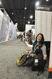 Phyllis Van Horn, a buyer from Vermont, reorganizes amid the SIA Snow Show Friday.