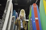 Brant Turner, account manager at SCSI Inc. out of southern California, displays his paddle boards at the SIA Snow Show at the Convention Center.