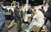 A unicorn pulled in a wagon provides free hugs at the SIA Snow Show on Friday at the Convention Center.