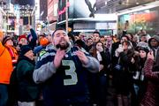 A Seattle Seahawks fan talks some enthusiastic trash to anyone who will listen at the NFL's Super Bowl Boulevard in Times Square, on Jan. 31.