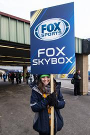 A woman helps direct guests of Fox Sports at the stadium.