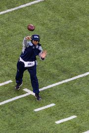 Seahawks quarterback Russel Wilson throws some warmup passes.