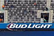 A few fans trickle in early, with a reminder that beer and Super Bowl go together like peas and carrots. Pregame at the MetLife Stadium in New Jersey, site of Super Bowl XLVIII between the Denver Broncos and Seattle Seahawks.