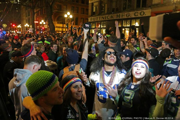 Hundreds of Seahawks fans flood First Avenue in Pioneer Square Sunday night after the Seahawks won the Super Bowl. Police closed down First as the crowd filled the area of First and Yesler into the night.