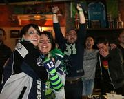 Seahawks fans at Fado Irish Pub in downtown Seattle go crazy as the Seahawks win the Super Bowl.