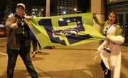 """Seahawks fans display a """"12"""" flag signifying the 12th Man designation for Seattle Seahawks fans. They are among hundreds of fans who flood First Avenue in Pioneer Square after the Seahawks win the Super Bowl."""