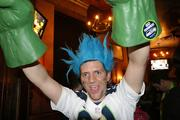 A Seahawks fan at Fado Irish Pub in downtown Seattle celebrates as the Seahawks win the Super Bowl on Sunday night.