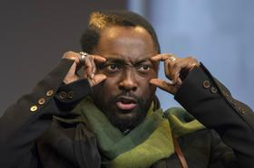 Recording artist Will. i. am gestures as he speaks at the Macworld/iWorld conference at the Moscone Center West in San Francisco in 2013.