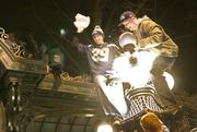 A Seahawks fan holds a broken light fixture from the historic pergola as people celebrate in Pioneer Square after the Seattle Seahawks victory in the Super Bowl.