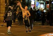 Seahawks fans high five in the middle of First Avenue in Seattle as they celebrate after the Seahawks win the Super Bowl. Police had closed the street.