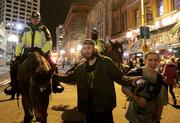 Seahawks fans stop to take their photo with Seattle Police horse patrol officers. Seattle police had tweeted a message that they would be present around the city overnight.