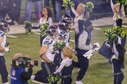 Seattle players rush onto the field before the game. The Seattle Seahawks defeated the Denver Broncos 43-8 in Super Bowl XLVIII, played Feb. 2, 2014, in New Jersey's MetLIfe Stadium.