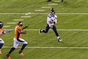 Seattle quarterback Russell Wilson throws on a rollout.