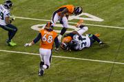 Seattle defensive back Kam Chancellor holds tight to the ball after making an interception.
