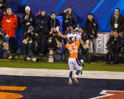 Denver defender Tony Carter commits pass interference in the end zone.