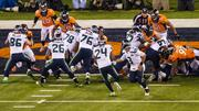 Seattle running back Marshawn Lynch gets the handoff on his way into the end zone for a touchdown.