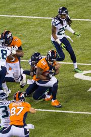 Denver receiver Demaryius Thomas makes a catch in traffic.