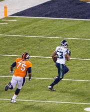 Seattle linebacker Malcolm Smith heads into the end zone for a touchdown after making an interception.