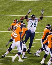 Denver's Peyton Manning tries to fire a pass over the hands of Seattle's Red Bryant.
