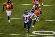 Seattle's Percy Harvin returns the opening kickoff of the second half for a touchdown. The Seattle Seahawks defeated the Denver Broncos 43-8 in Super Bowl XLVIII, played Feb. 2, 2014, in New Jersey's MetLIfe Stadium.
