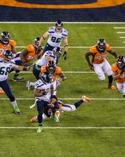 Seattle running back Marshawn Lynch finds some daylight up the middle.