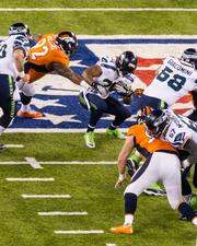 Seattle running back Marshawn Lynch looks for a hole.