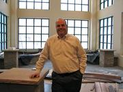 """John Mehrkens, vice president of development for Presbyterian Homes and Services' Senior Housing Partners division, gave MSPBJ a """"dirty boots"""" tour of the company's new Wayzata senior housing and assisted living community. He's standing in the conservatory."""