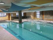 The swimming pool in the fitness center at The Promenade has a wheelchair ramp into the water instead of a chair lift.