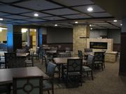 The kitchen is centralized in the complex to efficiently serve food in multiple settings, including this dining room.