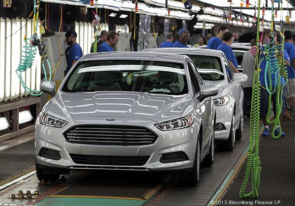 U.S. factories saw manufacturing growth slow last month as the cold weather brought in fewer orders. Pictured here are 2014 Ford Motor Co. Fusion vehicles moving down the production line at the Flat Rock Assembly Plant in Flat Rock, Michigan.