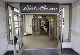 Today, Jos. A. Banks, the men's businesswear giant announced plans to acquire Eddie Bauer.  Here, a shopper leaves an Eddie Bauer store in Naperville, Illinois.