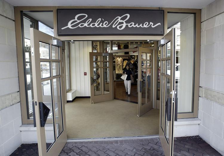 Today, Jos. A. Banks, the men's businesswear giant announced plans to acquire Eddie Bauer.  Here, a shopper leaves an Eddie Bauer store in Naperville, Ill.