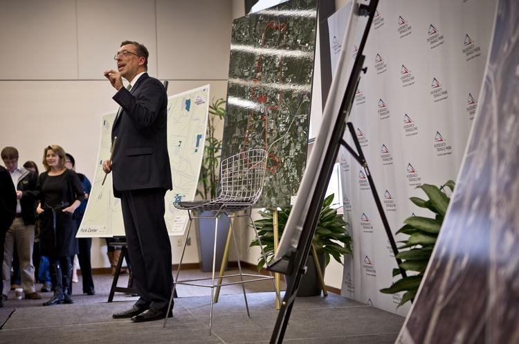 Bob Geolas, president and CEO of the Research Triangle Foundation, explains his plan to the crowd Monday.